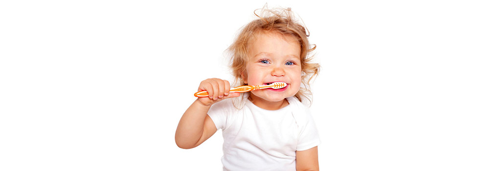 A toddler brushing her teeth