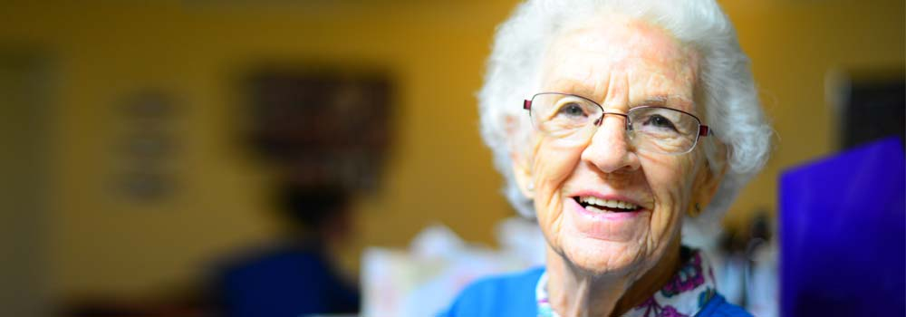 An older woman smiling - Dental care for older patients